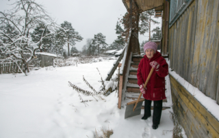 Elderly Shoveling - Sauers Snow Removal